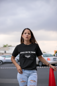 unisex-tee-mockup-of-a-woman-in-a-mall-parking-lot-23066